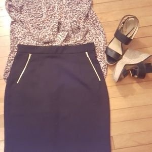 Black pencil skirt, gold accents